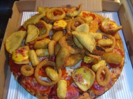 Yes, it's a junk food pizza.  Mini tacos, onion rings, and other assorted fried treats on a pizza.  (I feel strangely sick but fascinated by this!)