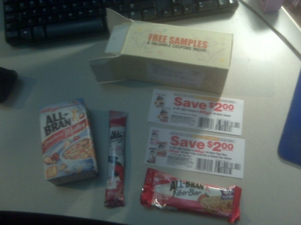 A little box of cereal, a drink mix, a fiber bar (half eaten during a commercial break at about 7:25) and two $2 off coupons! Sweet.