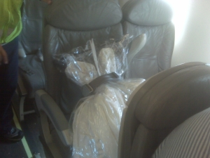 The dress got it's own seat!  Get this...a man on my flight was on his way to a wedding, or coming back from one, and needed a place to put his tuxedo, so the tux sat next to my gown!