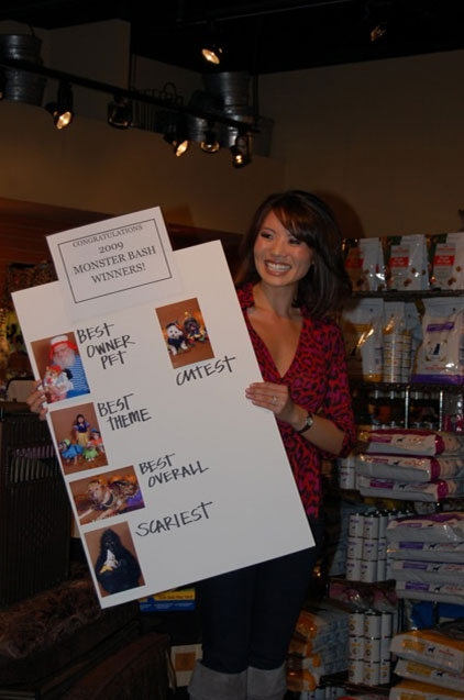 Me at Land of Paws, hosting a costume contest...I keep forgetting to post these photos.  Land of Paws certainly has a lot of treats for the pooches!  Thanks again to Debby for sending me this pic.