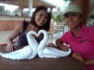 Here's another pic of my vacation down in Mexico.  Here I am with one of the awesome activeties people, holding a towl-shaping class.  If anyone needs to make a swan-shaped towel...or maybe a pig shaped one, I'm the woman to call.