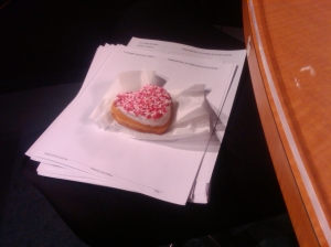 As you can see, mine is pink sprinkles, and is sitting beside me at the anchor desk. As soon as I got off the set, I quarrentined the donut into a plastic Tupperware, and that prevented me from eating it.
