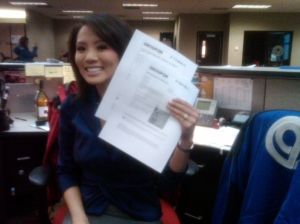 Here's a very unflattering photo of me and my newly-printed Groupons.