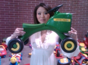 My producer and good friend Abbie wanted a John Deere tractor toy for her little boy, Ben.  So I sent her a picture of one at the sale, and ended up buying it for him!